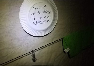 """A plate with the words """"You can get to Nome if you don't leave Rohn"""""""