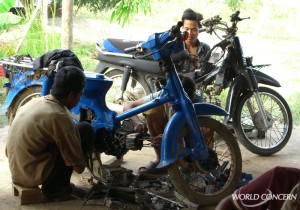 Young men learn how to repair motorcycles as part of the World Concern program to stop human trafficking.