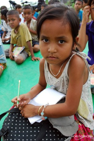 """""""School on a Mat"""" helps villagers know the dangers of child trafficking, while providing children with an education that incudes health, language, science and math."""