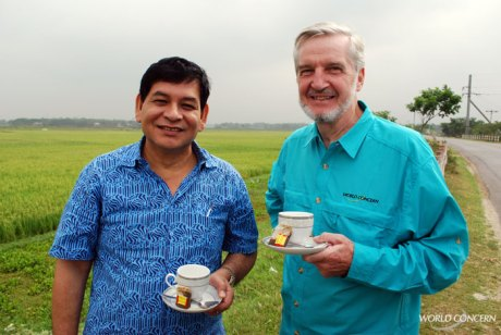 World Concern humanitarians enjoy a cup of tea on the way to visit projects in Bangladesh. On the left is Prodip Dowa, who leads the team in Bangladesh; on the right is Rick Johannessen, who oversees operations across Asia.