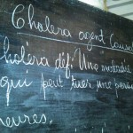 cholera information on a chalk board