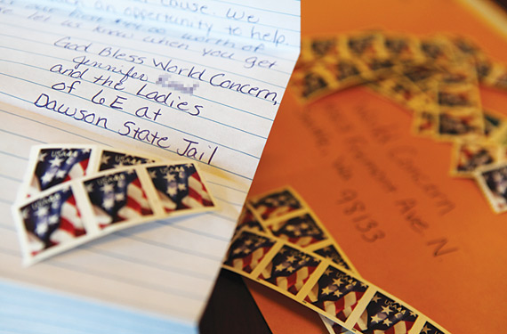 A letter and stamps from the women at Dawson State Jail.