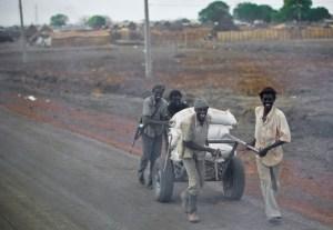 Men looting food in Sudan.
