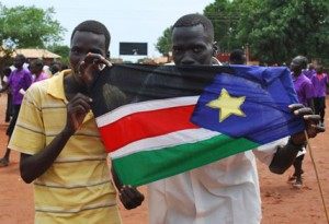 Holding the flag of South Sudan