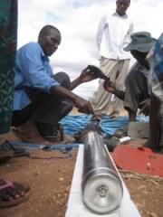 Engineers work on well pump.