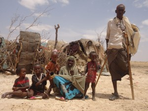 A disabled man with his family in Somaliland.