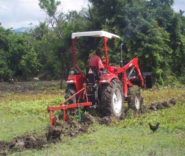 One of the project's tractors hard at work. The tractors are used to help local farmers during planting.
