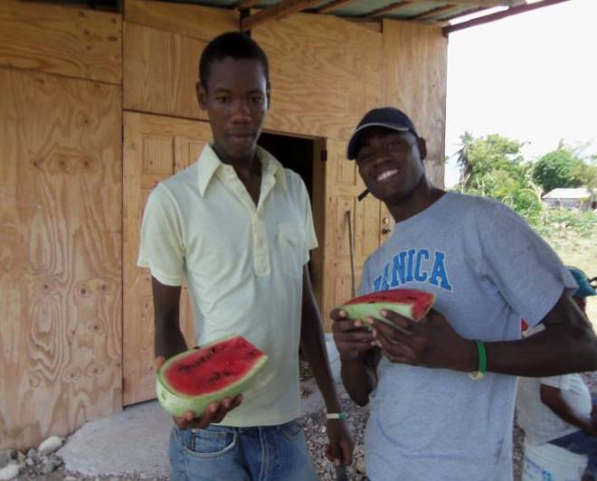 Youth interns at the training center in Haiti enjoying some watermelon.