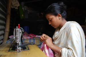 A woman sews in her business.