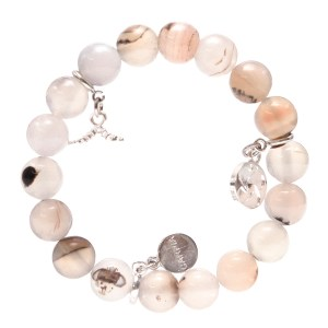 The World Concern bracelet comes in 3 colors, marbleized beige (shown here), fall brown, and black.