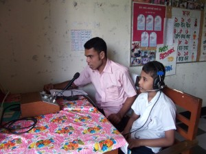 Asad teaches a hearing impaired boy to speak at World Concern's Hear School in Bangladesh. Asad learned to communicate at the same school as a child.
