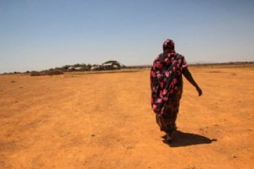 Moms in Somalia must walk long distances through the desert to collect water.