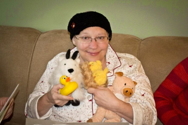 Patti on Christmas morning, 2012, with stuffed animals that symbolized the gifts given in her name to transform the lives of children around the world.