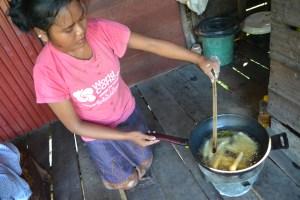 Leh making her sticky stick snacks.