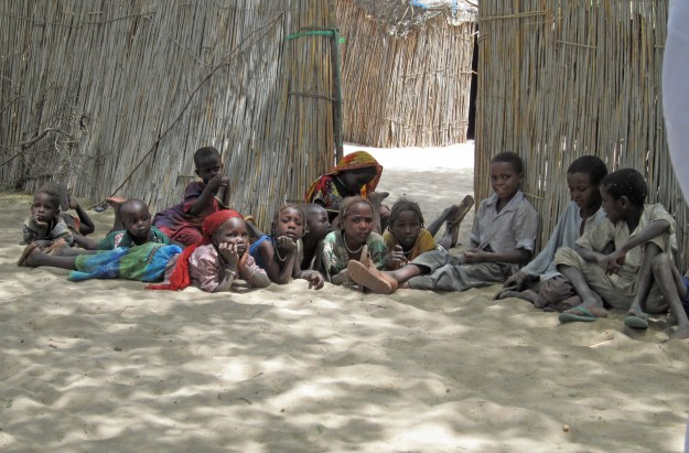 Kids rest at a refugee camp in Chad.