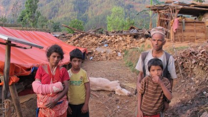 Him Kumari (left) was injured when her house collapsed on her during the earthquake. The cow behind her was dying when this photo was taken last week.