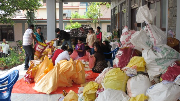 Nepali church volunteers joyfully put together earthquake survival kits for families affected by the earthquake.