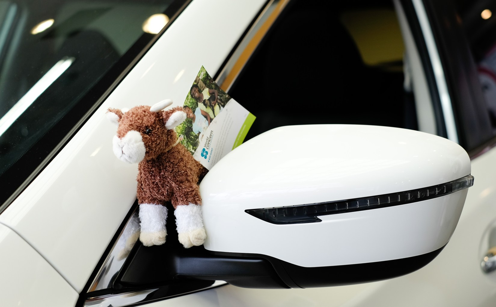 Sometimes it seems customers are more excited about their stuffed goats than their new cars which is saying a lot!