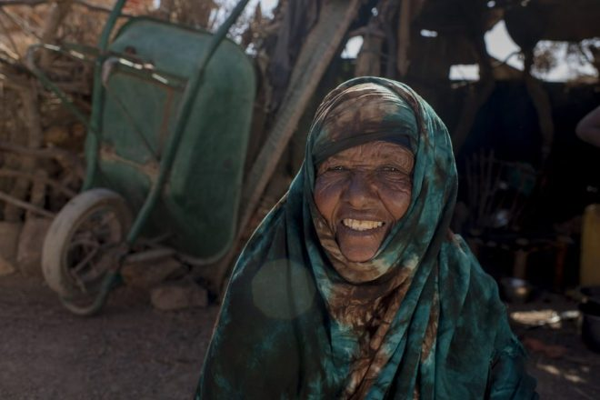 a woman sits outside her tent in Somalia