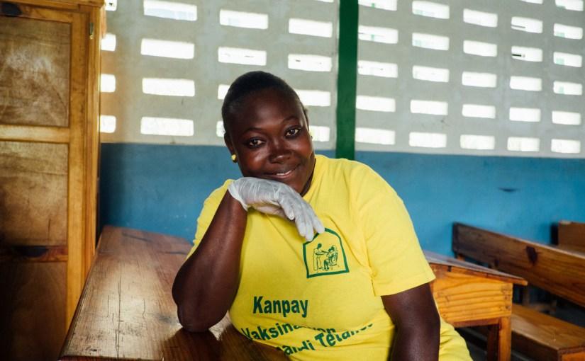 a nurse distributes deworming medicine