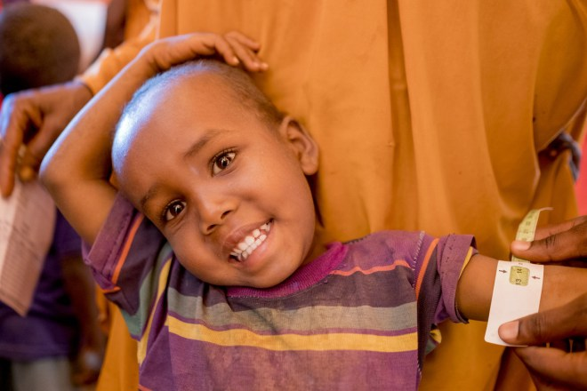 a boy is screened for malnutrition in Somalia