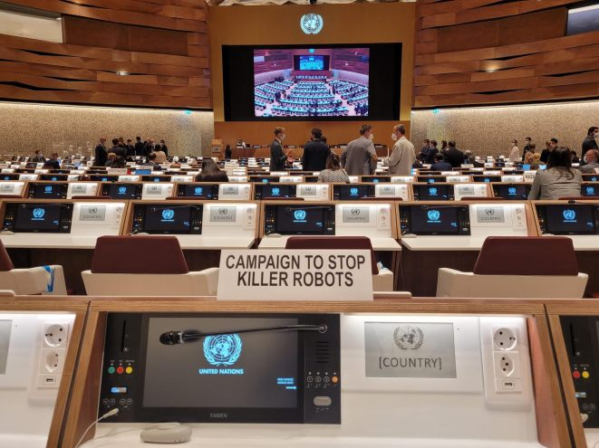 The picture depicts diplomats conversing in the meeting room during the August CCW meeting on autonomous weapons.