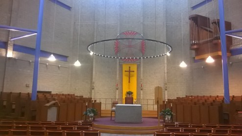 A minimalist Benedictine house of worship, choir stalls a plenty.