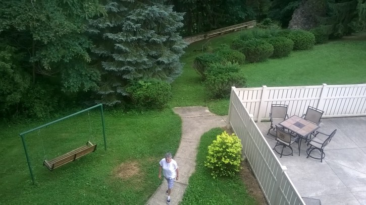 Second floor balcony view, a sister captured walking.