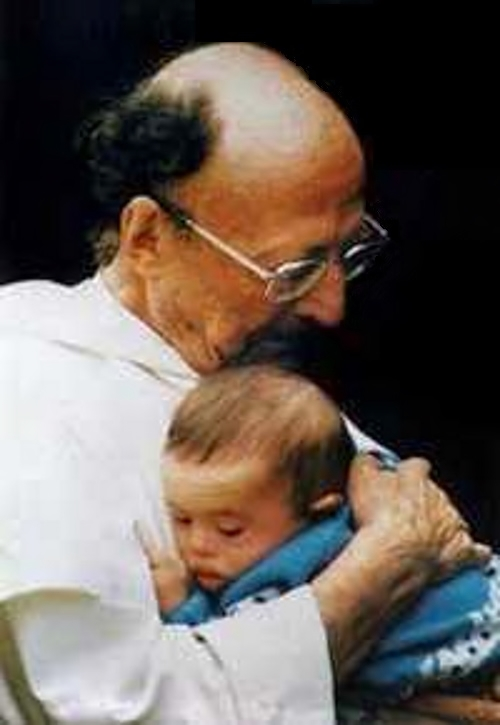 Father Thomas Philippe with a gifted child.