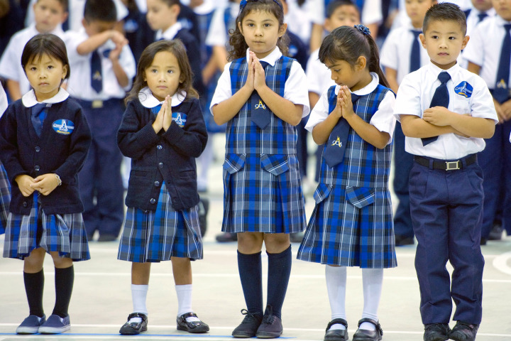 Sept. 9, 2013 - Garden Grove, California, U.S. - Children stand in prayer during the dedication ceremony for their new school, the Christ Cathedral Academy. The Most Rev. Kevin Vann, Bishop of Orange, blessed the building during the first day of school...///ADDITIONAL INFORMATION: – MINDY SCHAUER, ORANGE COUNTY REGISTER –.Shot 090913 –-.christcathedral.academy.The Most Rev. Kevin Vann, Bishop of Orange, will join students, teachers and families for the formal opening of the Roman Catholic Diocese of Orange's newest educational institution, the Christ Cathedral Academy. The new pre and k-8 school has the distinction of being located on the newly acquired 34 acre Christ Cathedral Campus. The school is housed within the former Family Life building and encompasses three floors and nearly 75,000 square feet. The Diocese has recently completed a more than $1.7 million renovation of the school facility. (Credit Image: © Mindy Schauer/The Orange County Register/ZUMAPRESS.com)