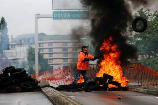 160602-world-france-strikes-fire-tyres-rouen-1230_4aa42f13cb82dab51e0df3c1bfeec92c-nbcnews-ux-2880-1000