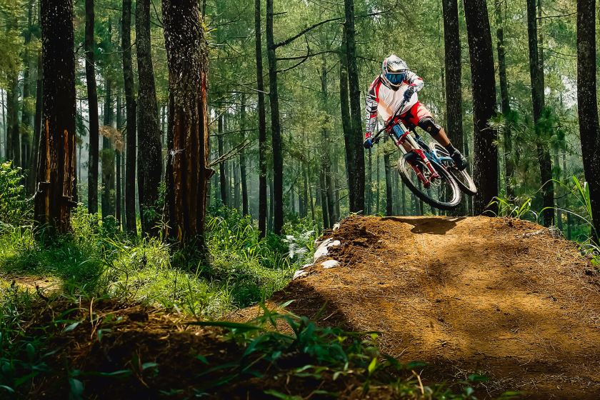 Mountain biker jumping in woods
