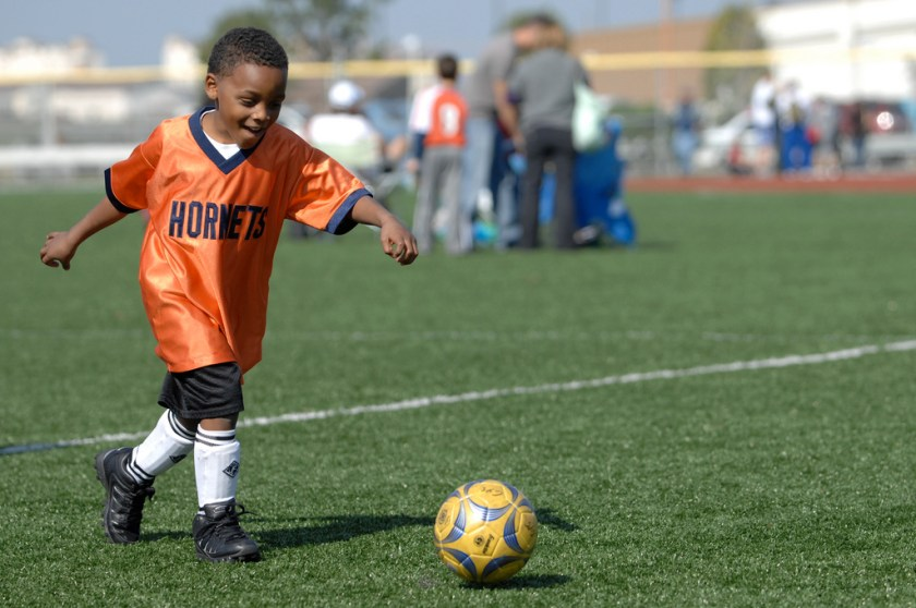 Child playing extracurricular school sport