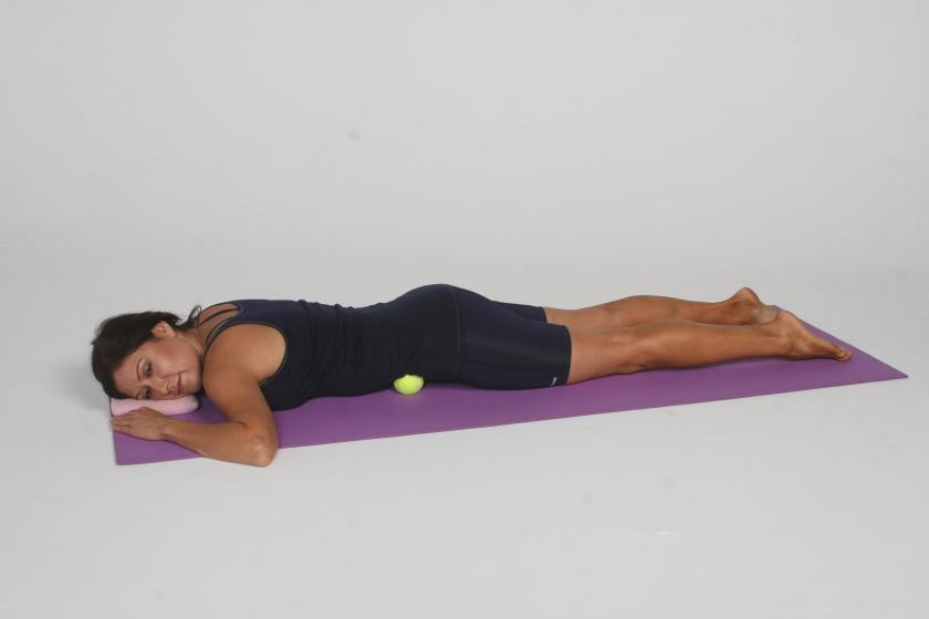 Using a tennis ball for self-myofascial release