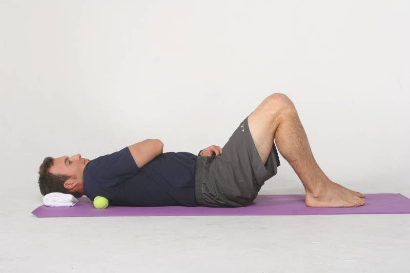 Using a tennis ball for self-myofascial release