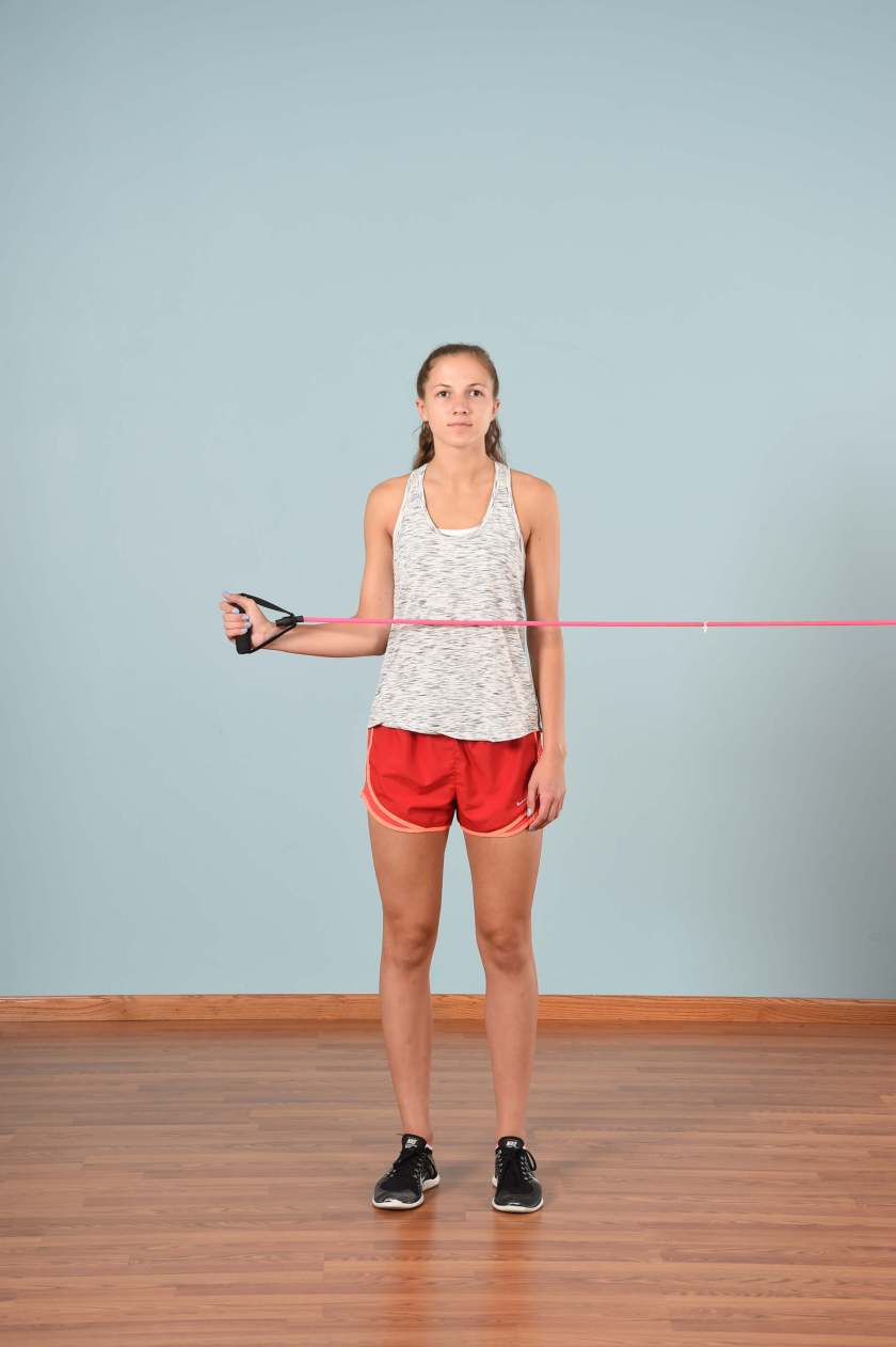Athlete performing an external rotation to activate the shoulder in RAMP warm-up