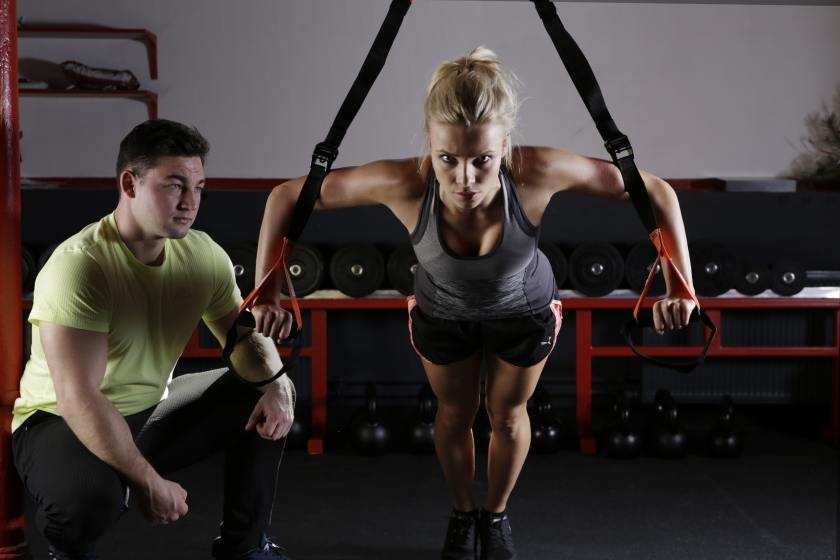 man and woman in the gym