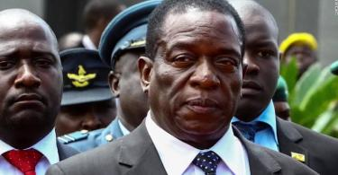 close up of mnangagwa with officials behind him