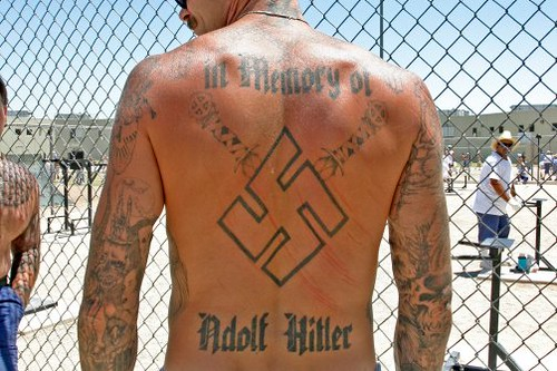 back neo nazi prison inmate with swastika and hitler tatoos