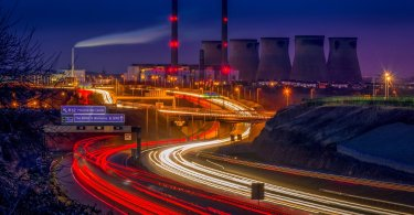Powerstation with timelapse of cars with lights on