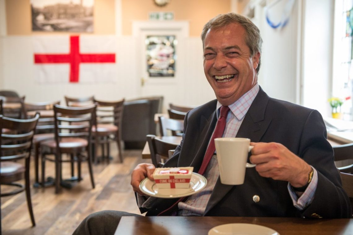 Farage with cup of tea and packet of butter in george's cross colours