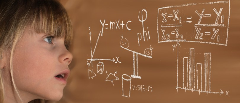 child's face next to board with equations