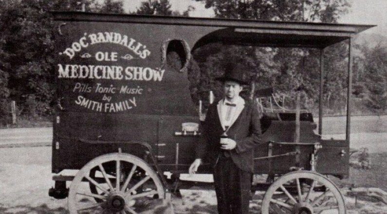 vintage photo of travelling snake oil salesman and wagon