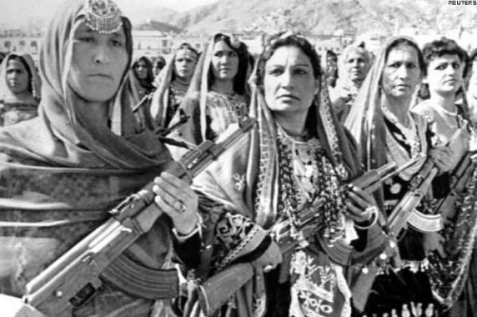 Armed Afghan women celebrating the anniversary of the Saur revolution in Kabul