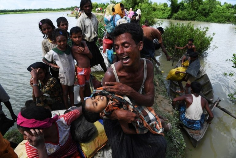 Winner, Photography - Spot News (English): Staring at death by Indranil Mukherjee of AFP.