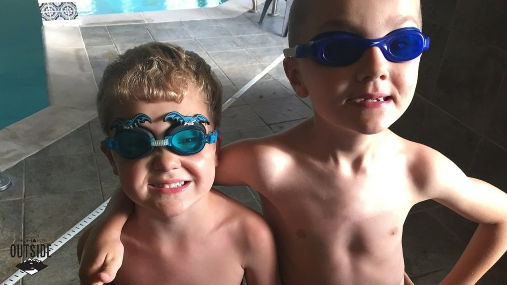 Two kids who are happy to be swimming and not, say, riding in a car.