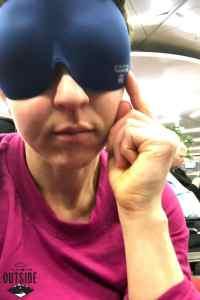 Amy wears a sleeping mask.