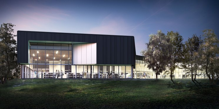 rendering of the Sherwood Community Centre from the lawns at dusk, with the interior of the building visible through floor-to-ceiling glazing