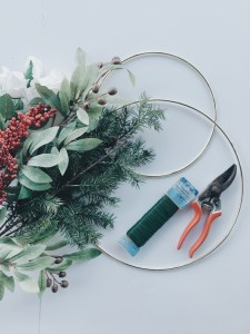 All of the materials used in making the holiday wreath