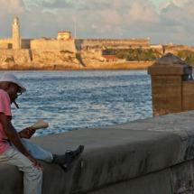 El Malecón, man reading (Havana)